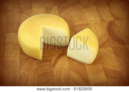 Cheese on kitchen board.