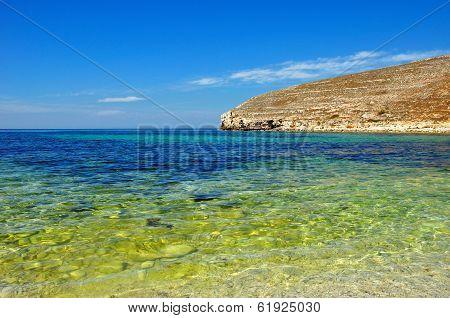 Beautiful Sea Against Cloudless Blue Sky And Mountines. Summer Seascape. Crimea