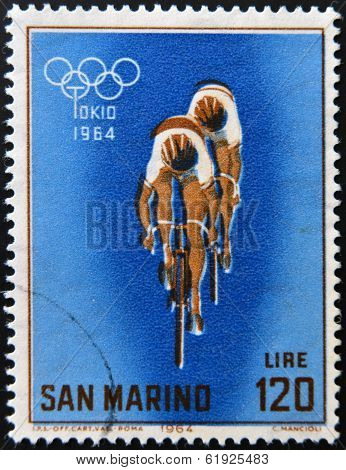 SAN MARINO - CIRCA 1964: A stamp printed in San Marino shows racing cyclists