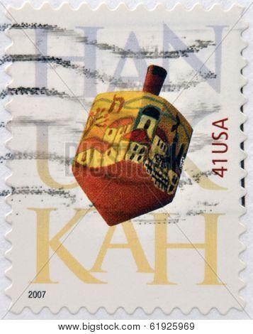 UNITED STATES OF AMERICA - CIRCA 2007: A stamp printed in USA dedicated to Hanukkah shows Dreidel