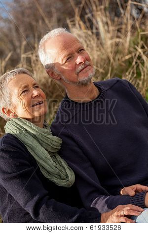 Happy Senior Couple Relaxing Together In The Sunshine
