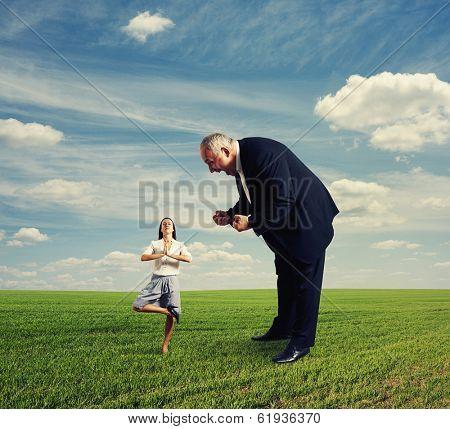 aggressive man and meditation woman at outdoor