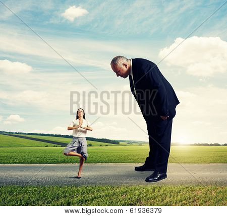 big boss looking at small meditation woman in the road