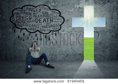 Depressed Man With Sign Of Cross