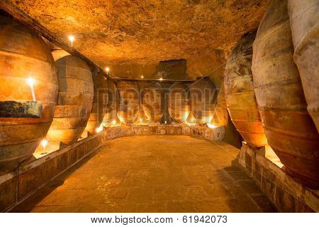 Antique winery in Spain with clay vessels terracotta amphora  pots Mediterranean tradition with candlelight