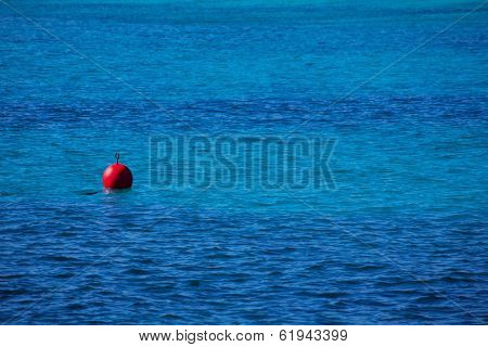red buoy  floating in  blue mediterranean sea perspective