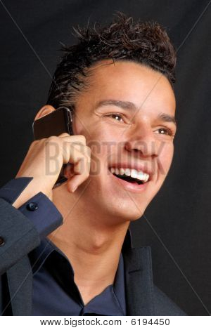 Smiling Young Business Man With Mobile