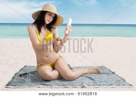 Woman Putting Sunblock