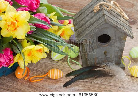 birdcage with spring flowers