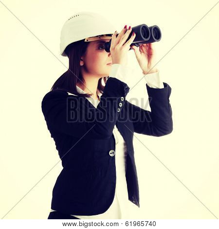 Business vision concept, engineer woman looking throught binoculars, isolated on white
