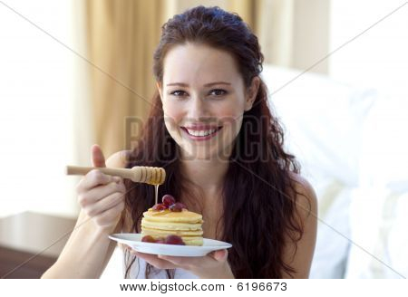Happy Woman Eating A Sweet Dessert