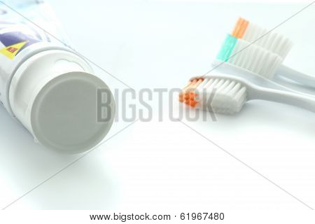 Toothpaste And Three Toothbrush