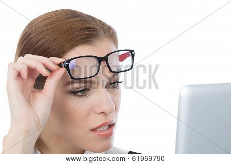 Woman With Glasses Looking At Her Laptop