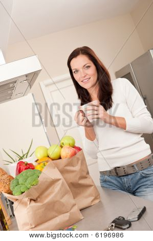Young Smiling Woman With Groceries