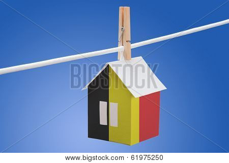 Belgian flag on paper house
