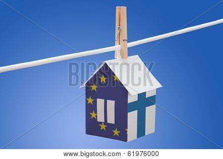 Finland and EU flag on paper house
