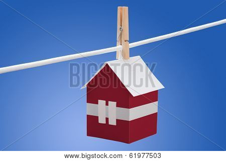 Latvia, Latvian flag on paper house