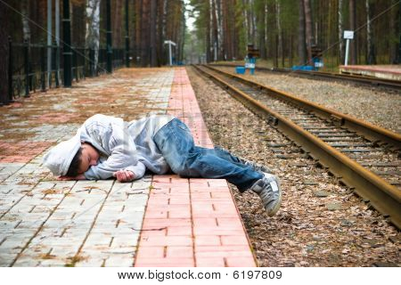 The guy sleeps expecting a train