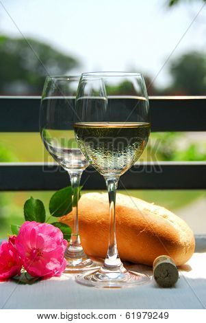 Two wine glasses with white wine