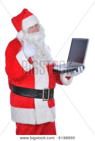 Santa Claus Holding Laptop Thumbs Up