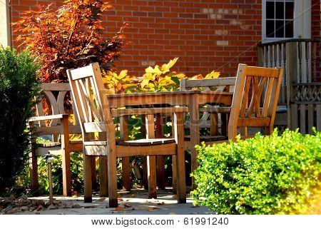 House patio with natural wooden patio furniture