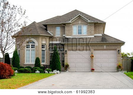New detached single family luxury home with brick facade