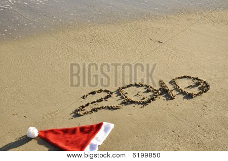 Santa Hat With New Year On The Sand.