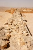 pic of sandstorms  - Wall of the ancient fortress in the desert during sandstorm - JPG