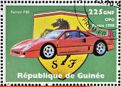 GUINEA - CIRCA 1998: Stamp printed in Guinea dedicated to anniversary of Enzo Ferrari shows Ferrari