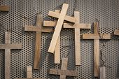 Wooden votive crucifixes.
