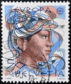 SWITZERLAND - CIRCA 1986: stamp printed in Switzerland shows woman circa 1986
