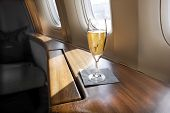 stock photo of first class  - A Glass of Champagne welcomes a First Class Passenger to a Flight - JPG