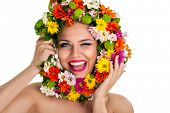 Funny girl holding flower wreath,  winking and laughing