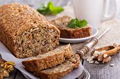 stock photo of ginger bread  - Vegan banana carrot bread with oats and nuts - JPG
