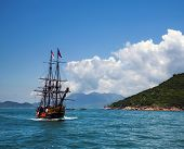 stock photo of historical ship  - Historic old ship in the ocean near the islands and beautiful panorama - JPG