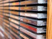 Rows of music cds in a cd holder, shallow dof