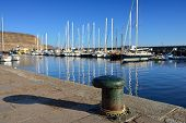stock photo of bollard  - Old mooring bollard in port of Puerto de Mogan Gran Canaria Spain - JPG