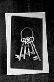 picture of skeleton key  - Old skeleton keys grouped on black and white stone background - JPG