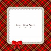 stock photo of tartan plaid  - A traditional plaid patterned frame accented with a small red ribbon - JPG
