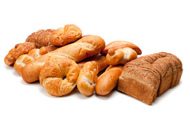 pic of whole-grain  - Assorted breads including croissants french bread whole grain on a white background - JPG