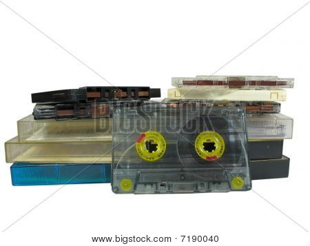 Pile Of Old Audio Cassettes Isolated Over White