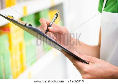 Supermarket Clerk At Work