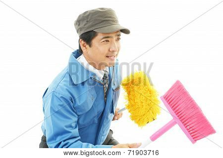 Smiling Asian janitor