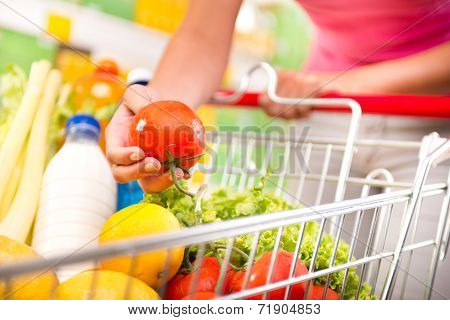 Full Shopping Cart At Supermarket