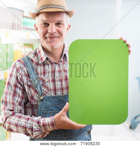 Farmer Holding Sign At Supermarket