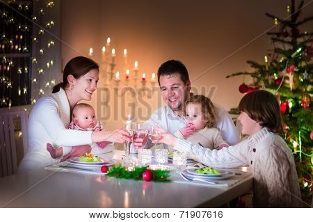 Big happy young family enjoying Christmas dinner
