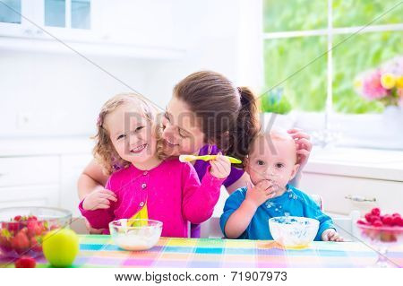 Mother And Kids Having Breakfast