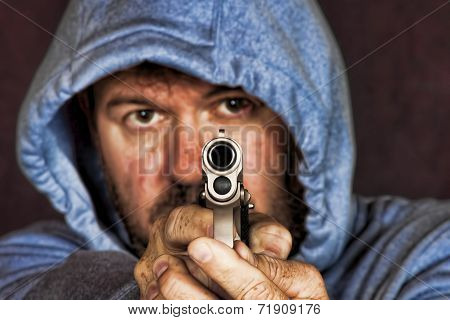 Thief Or Gang Member Holding A Handgun