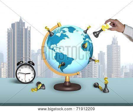 Hand Hold Dollar Chess On Terrestrial Globe With Alarm Clock