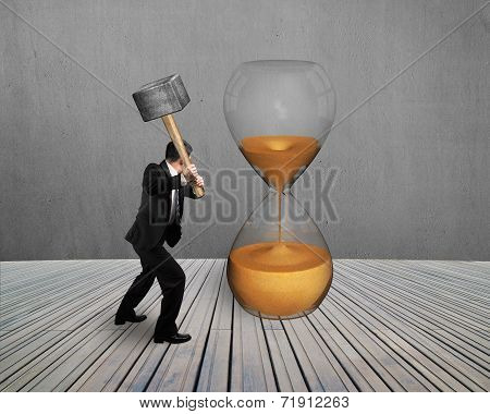 Hand Hold Hammer To Strike Hourglass